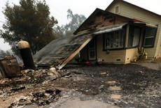 Wildfires burn Northern California, leaving at least 10 people dead